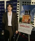 "<p>Zach Braff, the director and writer of the film ""Garden State"" poses as he arrives for the opening night of the 2004 Los Angeles Film Festival featuring a screening of the his film in Hollywood, June 17, 2004. REUTERS/Fred Prouser</p>"