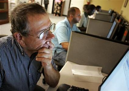 Stephen Battaglia (L) of West Palm Beach, Florida searches for jobs on a computer at Workforce Alliance in West Palm Beach, Florida July 2, 2009. REUTERS/Joe Skipper