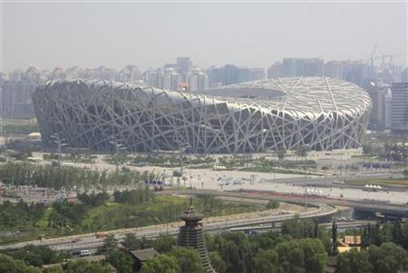The National Stadium, also known as the Bird's Nest, can be seen on a sunny day in Beijing July 3, 2009. REUTERS/David Gray
