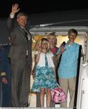 <p>Canada's Prime Minister Stephen Harper waves as he arrives in Rome with his daughter Rachel, wife Laureen and son Ben, July 7, 2009. REUTERS/Chris Wattie</p>