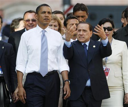 President Barack Obama is given a tour of the earthquake-hit Italian town of Onna by Italian Prime Minister Silvio Berlusconi, near the site of the annual G8 Summit in L'Aquila, July 8, 2009. REUTERS/Jason Reed