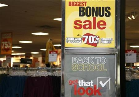 Signs announce a sale for ''back to school'' at a JC Penney Co store in Westminster, Colorado in this August 14, 2008 file photo. REUTERS/Rick Wilking