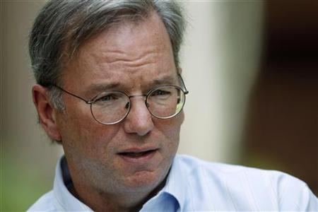 Google CEO Eric Schmidt talks to a reporter at the Sun Valley Inn in Sun Valley, Idaho July 9, 2009. REUTERS/Rick Wilking