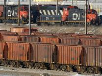 <p>In this file photo rail cars sit in the CN MacMillan Yard in Toronto February 10, 2007. Canadian National Railway Co said on Friday that it is ready to meet with two conciliators, recently appointed by Ottawa, and the Teamsters union to discuss a labor deal. REUTERS/J.P. Moczulski</p>
