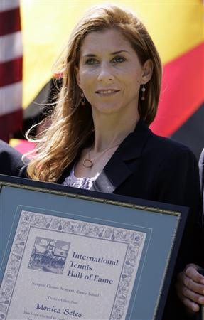 Former tennis player Monica Seles poses with her plaque after being inducted into the International Tennis Hall of Fame in Newport, Rhode Island July 11, 2009. REUTERS/Adam Hunger