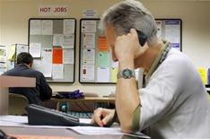 <p>A job seeker makes a phone call to a potential employer at The Work Place, which provides comprehensive employment and career services in Boston, Massachusetts July 2, 2009. REUTERS/Brian Snyder</p>