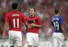 <p>Michael Owen saiu do banco de reservas para marcar o gol da vitória do Manchester United em sua estreia sobre o Malaysia XI por 3 x 2, neste sábado, na abertura da turnê pré-temporada do campeão inglês pela Ásia. REUTERS/Zainal Abd Halim (MALAYSIA SPORT SOCCER)</p>