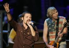 "<p>Singer Mac Powell (L) and guitarist Brad Avery, of the Christian rock group ""Third Day,"" perform at Madison Square Garden in New York, September 1, 2004. REUTERS/Gary Hershorn</p>"