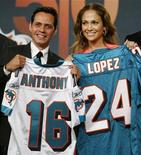 <p>Marc Anthony and his wife Jennifer Lopez hold Miami Dolphins jerseys with their names and birth dates during a news conference announcing his minority ownership in the team in New York July 21, 2009. REUTERS/Shannon Stapleton</p>