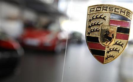 The logo of German car manufacturer Porsche is seen inside a showroom of a Porsche dealer in Frankfurt, July 21, 2009. REUTERS/Kai Pfaffenbach