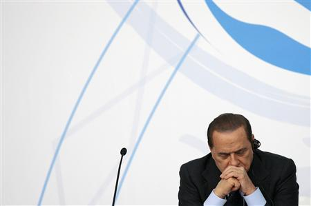 Italian Prime Minister Silvio Berlusconi reacts during the ''Milano Med Forum 2009'', in downtown Milan July 20, 2009. REUTERS/Alessandro Garofalo