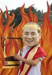 """<p>Активист негосударственнойорганизации """"Oxfam"""" одел маску итальянского премьер-министра Сильвио Берлускони в роли императора Нерона в Circo Massimo (""""Величайший цирк"""") в Риме 6 июля 2009 года. Премьер-министр Италии Сильвио Берлускони, преследуемый чередой обвинений в фривольных связях с несовершеннолетними девушками и дорогостоящими проститутками, признался, что он """"не святой"""", и торжественно пообещал продолжать руководить правительством до окончания мандата. REUTERS/Max Rossi</p>"""