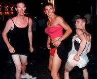 <p>Британцы, переодетые в женщин, на вечеринке в курортном городе Айя-Напа, Кипр. Киприоты шокированы дикими сексуальными оргиями, которые туристы устраивают в открытом море во время морских криузов. REUTERS/Andreas Manolis</p>