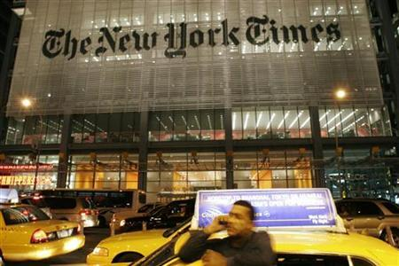 A man speaks on his mobile photo in front of the New York Times building in New York City May 21, 2009. REUTERS/Joel Boh