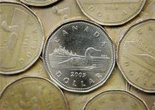 <p>A Canadian one dollar coin, also know as a loonie, is shown in Montreal, April 28, 2006. REUTERS/Shaun Best/File</p>