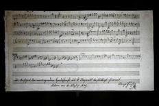 <p>A musical score handwritten by Wolfgang Amadeus Mozart is displayed in Nantes, western France, January 22, 2009.The International Mozarteum Foundation in Salzburg, Austria, said it had discovered two new works by Austrian composer Wolfgang Amadeus Mozart. REUTERS/Stephane Mahe</p>