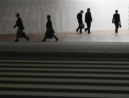 Pedestrians in Tokyo's central business district in a file photo. REUTERS/Kim Kyung-Hoon