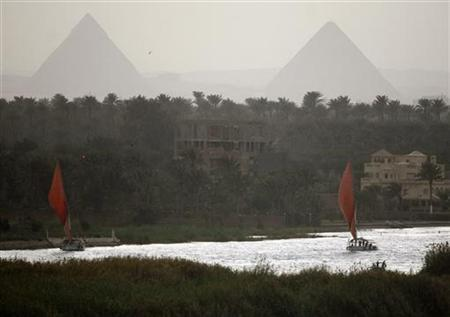 Boats sail on the river Nile in Cairo March 9, 2009. REUTERS/Asmaa Waguih
