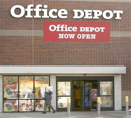 A customer leaves an Office Depot in a file photo. REUTERS/Rick Wilking