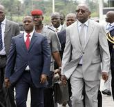 <p>Ivory Coast's President Laurent Gbagbo (R) and Prime Minister Guillaume Soro at Yamoussoukro airport to welcome visiting Ghanaian President John Atta Mills, April 7, 2009. REUTERS/Luc Gnago</p>