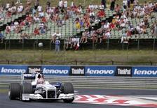 """<p>Польский пилот Роберт Кубица в """"Формуле-1"""" за рулем BMW Sauber во время Гран-При Венгрии 26 июля 2009 года в Будапеште. Автомобильная компания BMW подтвердила свое решение покинуть чемпионат мира по автогонкам в классе """"Формула-1"""" после сезона 2009 года, и сообщила, что потратит сэкономленные деньги на новые разработки. REUTERS/Stoyan Nenov</p>"""