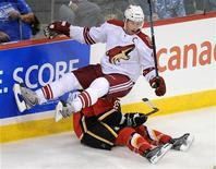 <p>In this file photo Phoenix Coyotes Shane Doan (top) falls on Calgary Flames Rhett Warrener during third period exhibition National Hockey League action in Winnipeg, September 24, 2008. REUTERS/Fred Greenslade</p>