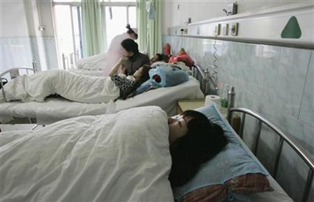 Xiao Hong, a young Chinese surrogate mother, looks up at the ceiling in the maternity ward of Guangzhou's Taihe Hospital where she said she was forced into an abortion by the city's family planning officials February 28, 2009. REUTERS/James Pomfret