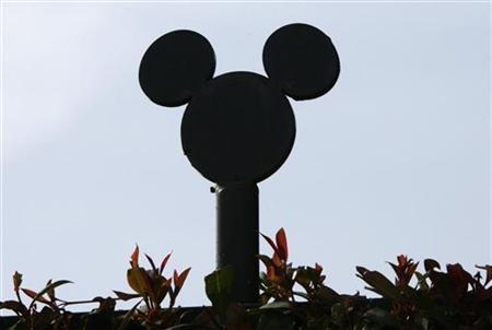 The silhouette of Disney character Mickey Mouse, which tops fencing at the Walt Disney Co. compound, is pictured in Burbank, California May 5, 2009. REUTERS/Fred Prouser