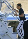 <p>Piloto da Ferrari Felipe Massa embarca em avião fretado em Budapeste para voltar ao Brasil 03/08/2009 REUTERS/Viktor Veres</p>