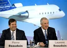 <p>Bombardier Inc.'s Laurent Beaudoin (R), chairman of the board of directors and his son Pierre Beaudoin, president and chief executive officer wait for the start of the company's annual general meeting in Montreal, June 3, 2009. REUTERS/Christinne Muschi</p>