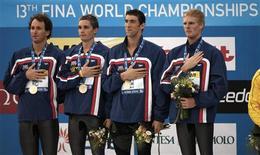 <p>Michael Phelps ajudou os EUA a quebrar o recorde mundial e conquistar a vitória no revezamento dos 4x100 medley no campeonato mundial neste domingo. REUTERS/Wolfgang Rattay</p>