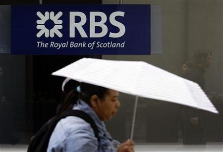 A woman passes a Royal Bank of Scotland branch in central London May 8, 2009. REUTERS/Stefan Wermuth