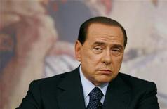 <p>Italy's Prime Minister Silvio Berlusconi listens to a journalist's question as he addresses a news conference at Chigi Palace in Rome July 7, 2009. REUTERS/Alessia Pierdomenico</p>