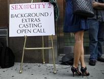 """<p>A woman waits in line for an open casting call for the filming of the movie """"Sex And The City 2"""" in New York August 4, 2009. The all-day casting call for background performers drew hundreds of union and non-union actors hoping for a part in the sequel to the 2008 film """"Sex And The City"""", the film adaptation of the HBO television series of the same name. REUTERS/Mike Segar</p>"""