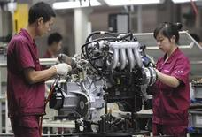 <p>Employees assemble an engine at the production line of Anhui Jianghuai Automobile Co., Ltd. in Hefei, Anhui province July 16, 2009. REUTERS/Jianan Yu</p>