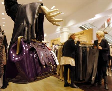 Shoppers browse racks of clothes during a sale at a David Jones department store in Sydney June 3, 2009. REUTERS/Tim Wimborne