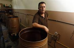 <p>Elias K., a Christian veteran of the South Lebanese Army (SLA), the now-defunct Israeli-allied militia, poses in his distillery in Moshav Goren just south of the Israel-Lebanon border August 3, 2009. REUTERS/Baz Ratner</p>