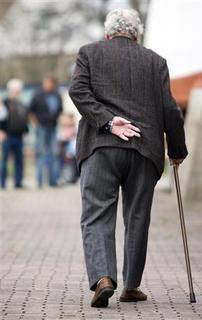 An elderly takes a stroll in Datteln, Germany in this April 16, 2006 file photo. REUTERS/Kirsten Neumann/Files