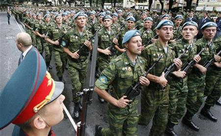 Russian soldiers march during a parade during a visit of Russia's President Dmitry Medvedev to their unit in Vladikavkaz, August 8, 2009. REUTERS/Sergei Karpukhin