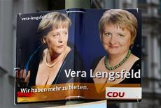 <p>An election campaign poster for the upcoming general election with the words ' We have more to offer' shows German Chancellor Angela Merkel (L) of the conservative Christian Democratic Union party (CDU) and Vera Lengsfeld, candidate of the CDU at Berlin's Friedrichshain-Kreuzberg district in Berlin, August 10, 2009. REUTERS/Fabrizio Bensch</p>