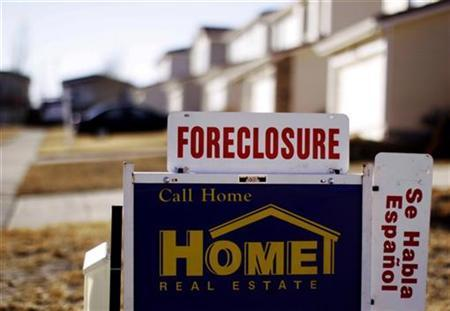 The sign for a foreclosed house for sale sits at the property in Denver, Colorado in this March 4, 2009 file photo. REUTERS/Rick Wilking