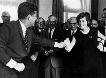 <p>Eunice Kennedy Shriver is greeted by her brother, the late President John F. Kennedy, during a bill signing at the White House. Reuters/Courtesy of the Special Olympics/Handout</p>