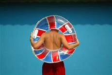 <p>A youth heads for the seafront with an inflatable Union flag decorated swimming ring in Hastings in this file photo. REUTERS/Peter Macdiarmid</p>