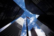 <p>Skyscrapers loom over a flagpole carrying the Canadian flag in the financial district in Toronto in this March 11, 2009 file photo. REUTERS/Mark Blinch</p>