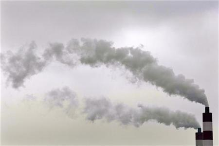 Smokes rise from chimneys of a coal-fired power station in Shanghai August 11, 2009. REUTERS/Aly Song