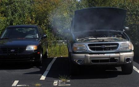 Smokes comes from the engine of a ''clunker'' that is being permanently disabled as part of the U.S. government's ''Cash for Clunkers'' program at Clark Chrysler Jeep dealership in Methuen, Massachusetts August 7, 2009. REUTERS/Brian Snyder