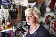 <p>Munira Babic awaits rare customers in her souvenir shop in historic Turkish quarter of the Bosnian capital of Sarajevo on August 10, 2009. REUTERS/ Danilo Krstanovic</p>