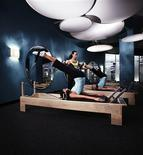 <p>Pilates instructor Michele Bastos guides a Reformer class at Crunch, New York City in this undated handout photo. REUTERS/Crunch/Handout</p>