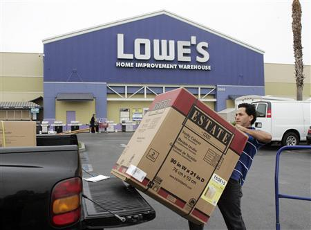 A contractor loads a bathroom vanity cabinet onto his truck after purchasing it at a Lowe's store in Burbank, August 17, 2009. REUTERS/Fred Prouser