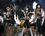 <p>KISS basist Gene Simmons (L), lead guitarist Tommy Thayer (C) and lead singer Paul Stanley perform during the Summer Festival in Quebec City July 16, 2009. REUTERS/Mathieu Belanger</p>